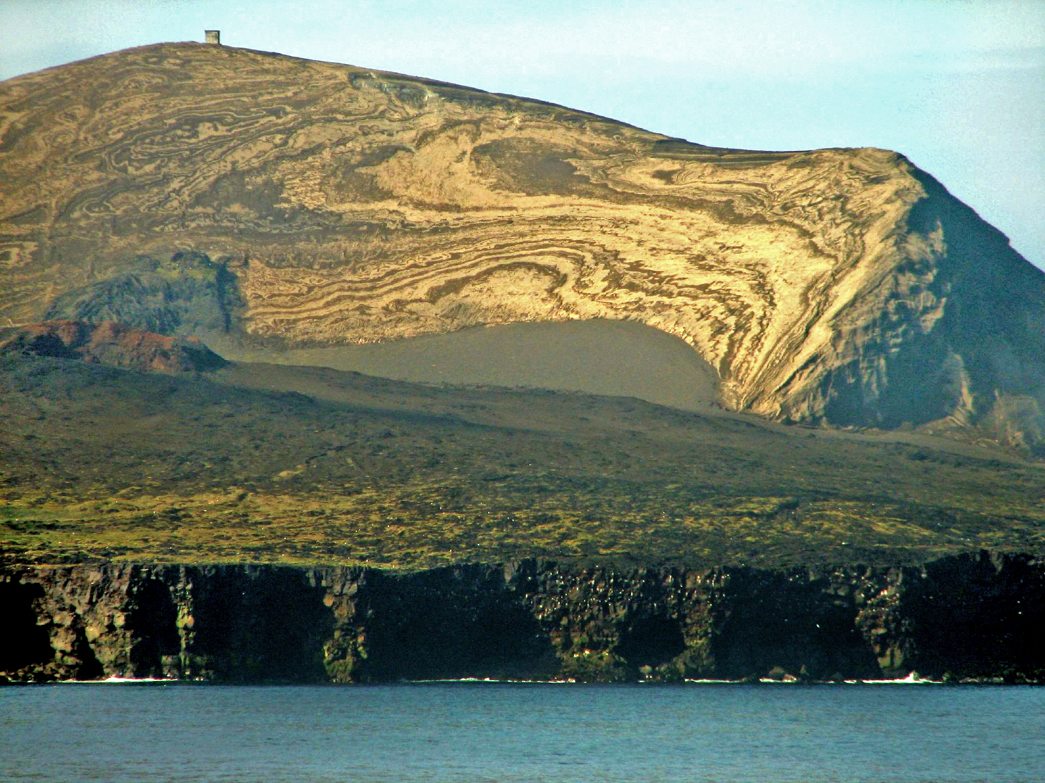 View of Iceland's not-so-old Surtsey Island from its coastal cliffs